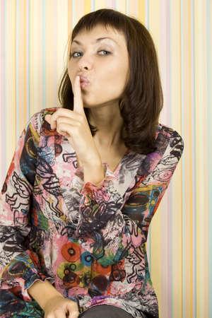 shushing: Young Woman Gesturing for Quiet or Shushing