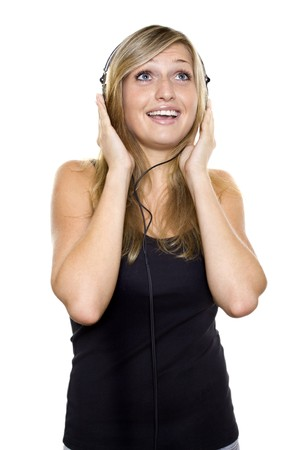 Woman listening to music and singing.  Stock Photo - 7784440