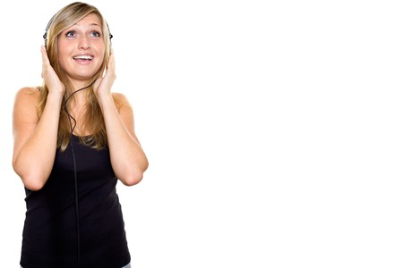 Woman listening to music and singing. Stock Photo - 7784402