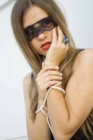 blindfolded: Beautiful woman Stock Photo