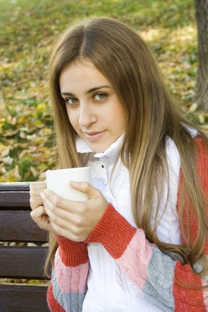 Girl holding coffee cup and smiling photo