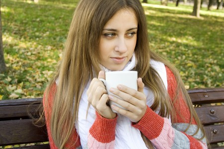 Girl holding coffee cup  photo