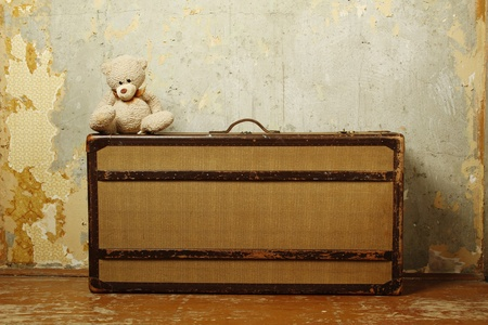 abandoned room: Suitcase with Teddy