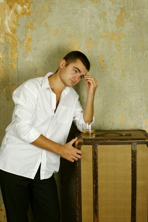 Young man with a whiskey photo