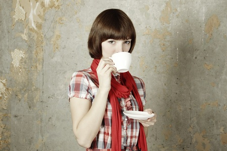 Young girl drinking coffee photo