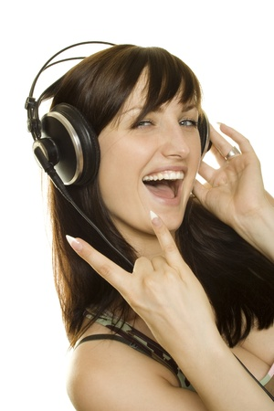 Woman listening to music and singing photo