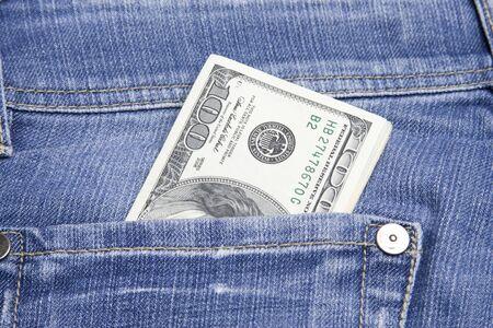 pochette: U.S. 100 dollar bills in his back pocket jeans blue