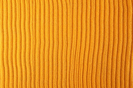 Texture of the orange sand which rakes made strips. Background