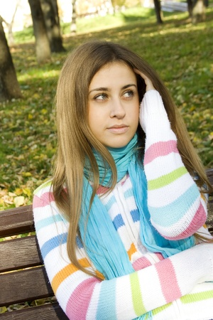 Young woman on a park bench photo