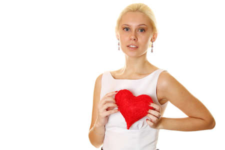 Young woman holding red heart photo