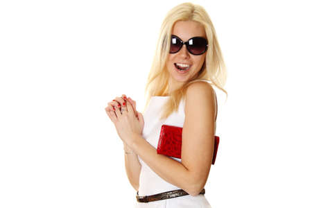 Trendy woman with sunglasses holding red handbag photo