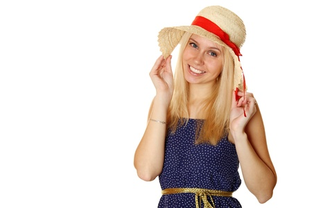 Beautiful young blond woman in a straw hat photo