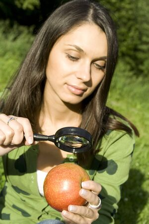 Checking the apple on the natural photo