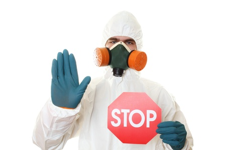 protective suit: Man in protective suit with a sign STOP