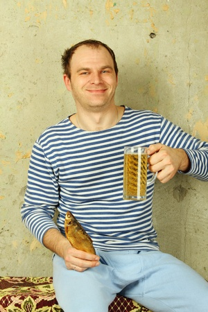 Closeup of a man with a glass of beer photo