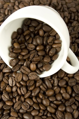 untidiness: Coffee beans are scattered from a white cup