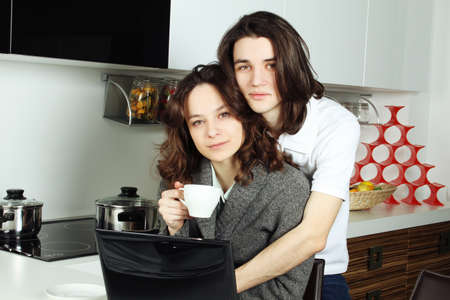 Happy couple in their kitchen photo