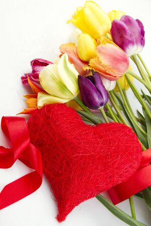 Tulips and red heart photo