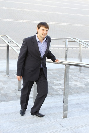 Businessman climbing stairs photo