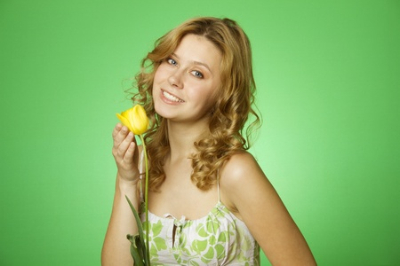 Happy Young Woman Hugging Flower Stock Photo