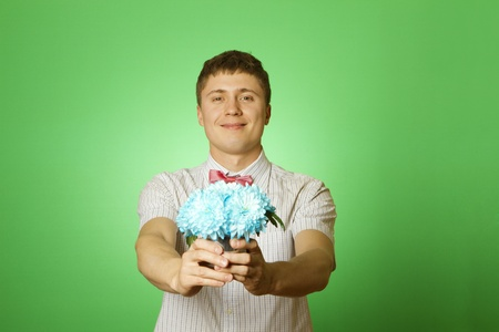 Lover man nerd with a bouquet of flowers photo