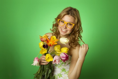 Happy Young Woman hugging a bouquet of tulips photo