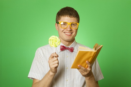 Young man bookworm reading photo