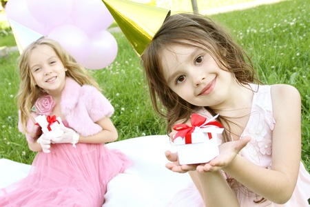 party dress: Childrens Birthday Party outdoors Stock Photo