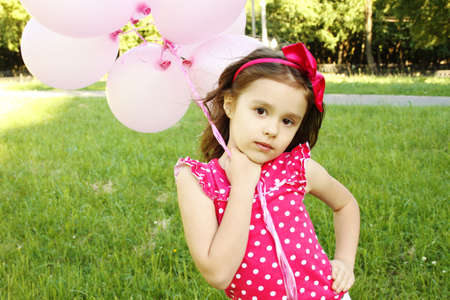 Little Girl in the Park with pink balloons photo