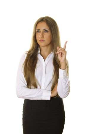 Beautiful businesswoman pointing at copyspace photo