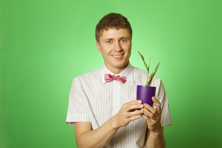 observes: Man observes cultivation of young plants Stock Photo