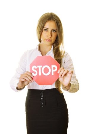 Close-up of an attractive young business woman holding a stop sign. Isolated on a white background photo
