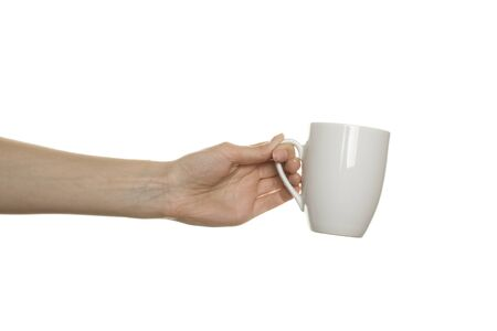 White cup in the female hand photo