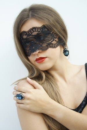 lace up: Mysterious pretty fashionable girl blindfolded black lace ribbon on a finger ring fit with a large blue gemstone