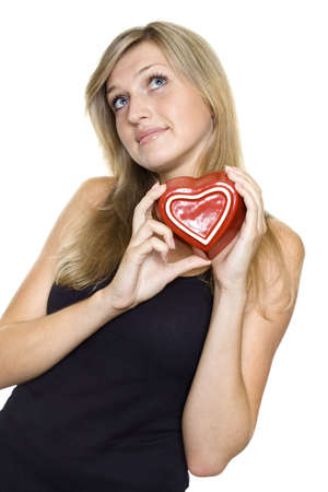 Smiling Young Woman Holding a red Heart. Lots of copyspace and room for text on this isolate photo