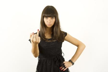 Een aantrekkelijke jonge vrouw met een vinger zonder ring Stockfoto