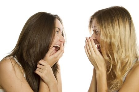 Two young women terrified and screaming photo
