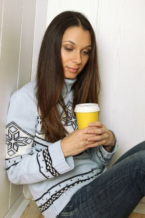25 to 30: Woman with a glass of coffee Stock Photo
