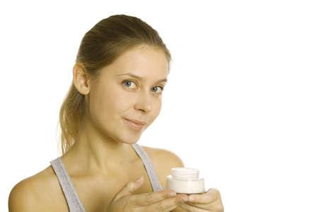 Beautiful girl holding cream photo