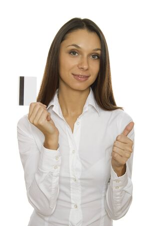 Young businesswoman holding credit card photo