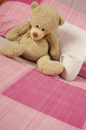 tassles: Teddy Bear in Bed Stock Photo