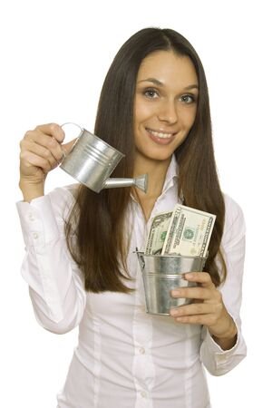 bucket of money: Profit Stock Photo