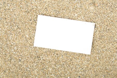 Businesscard on sand photo