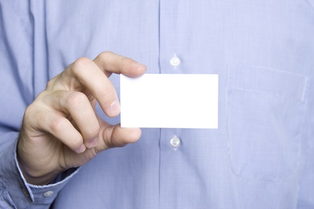 Business man holding blank card photo