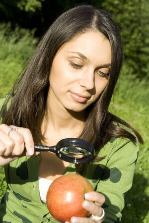Checking the apple on the natural Stock Photo - 13009231