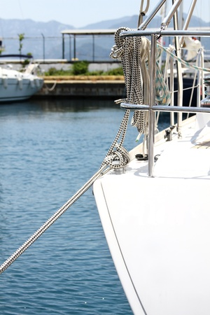 Close-up of mooring sailing yacht. Rope. node photo