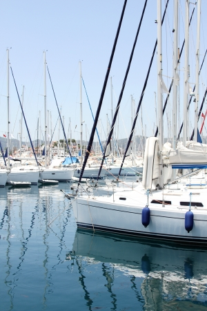 Many boats moored in the harbor  Marina in the Mediterranean photo