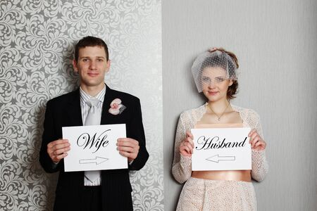 mr and mrs: Bride and groom holding white sheets with the text  Mr  ,  Mrs   Stock Photo