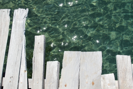 Close-up of a wooden bridge and the sea photo