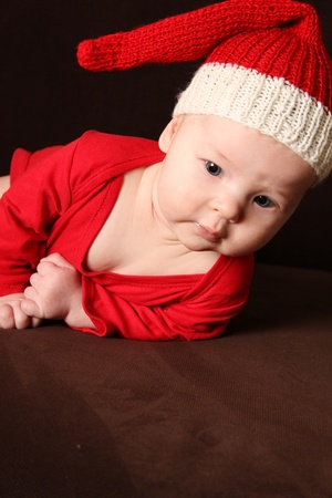 Close-up of a small child in a red knitted cap photo